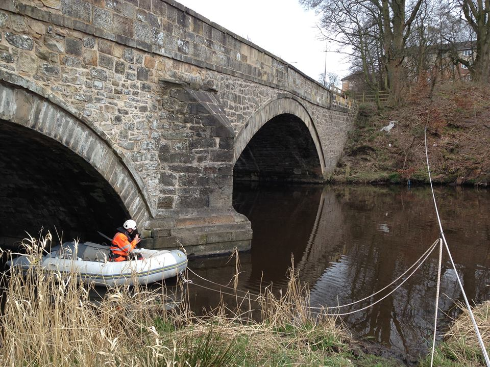Inflatable dingy used for bat survey of bridge